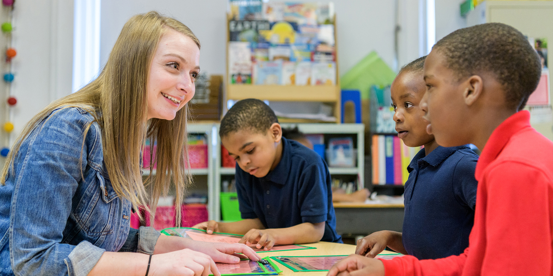Student teacher helps students with an assignment