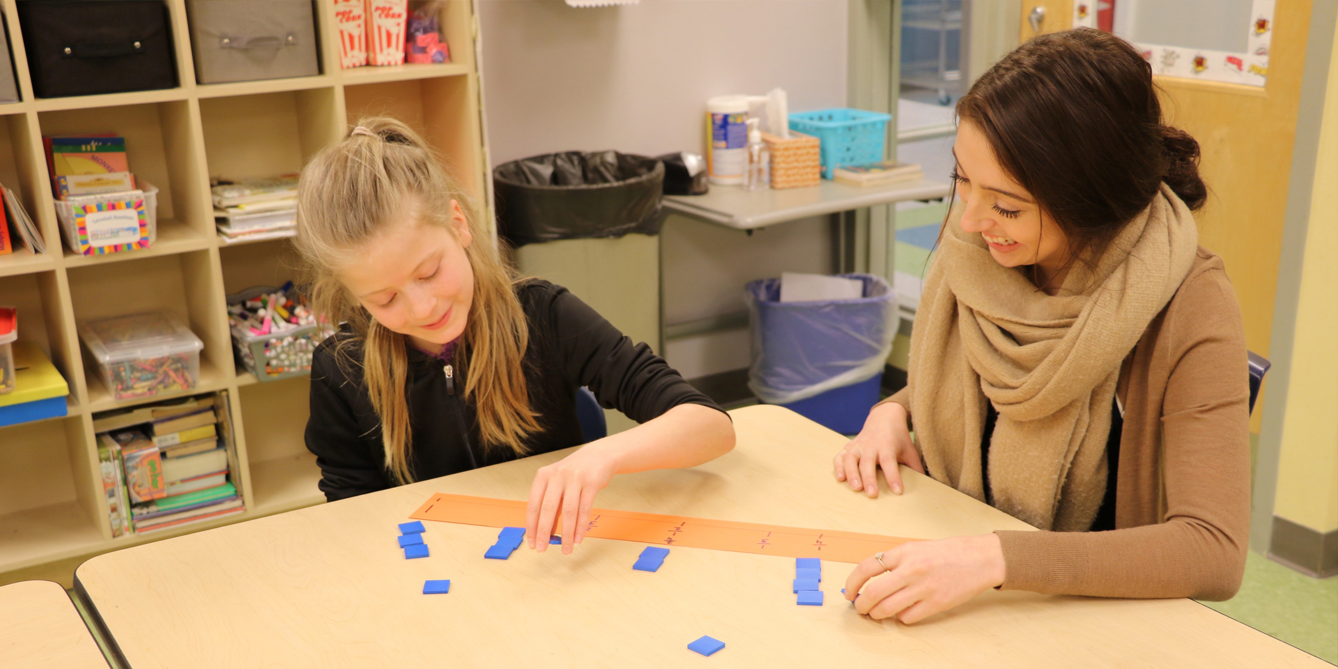 Student teacher teaches a student about fractions with a number line