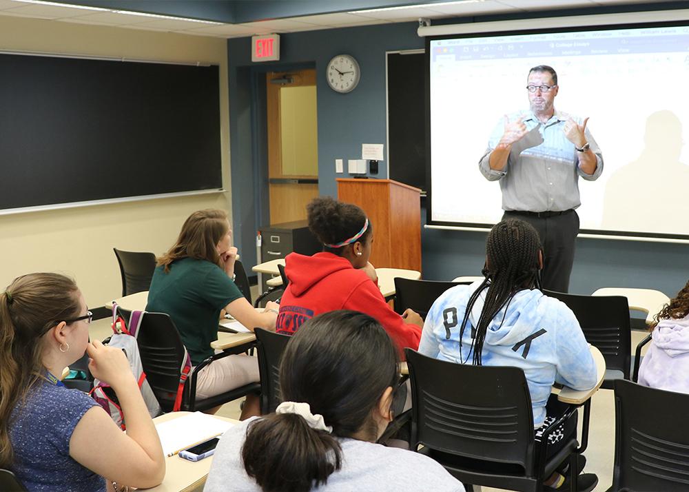 Teacher speaks to high school students in classroom