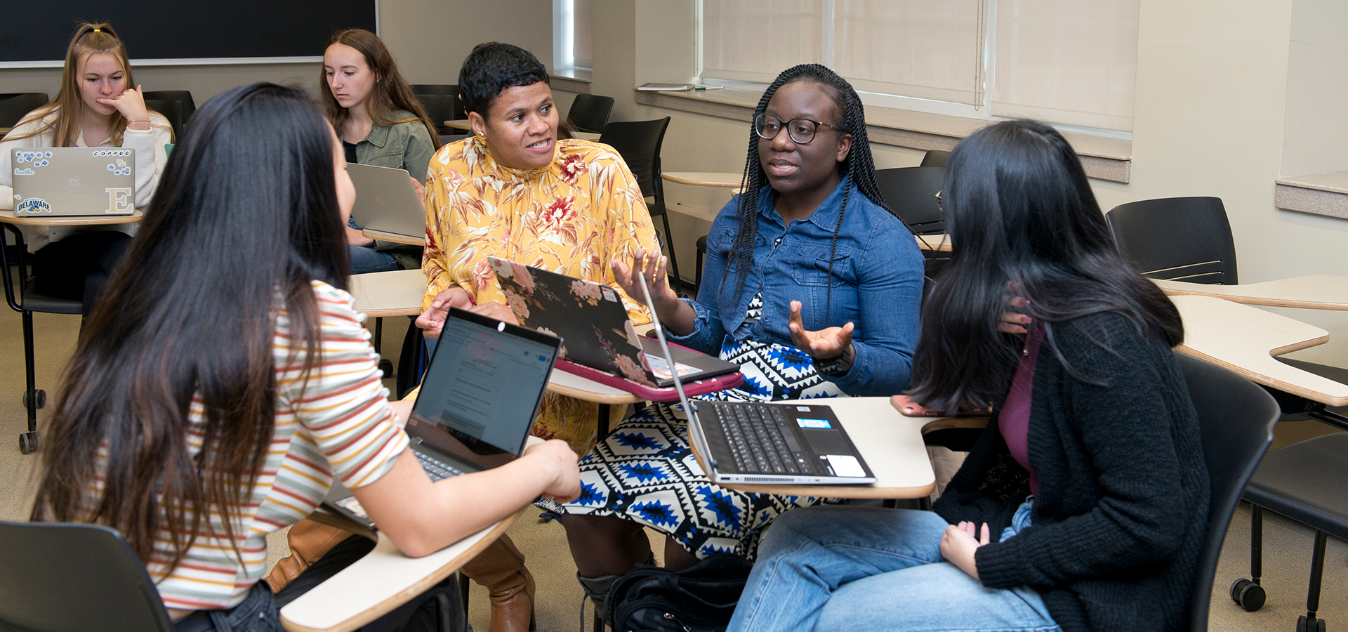 Janine de Novais speaks with students in her racial literacy class